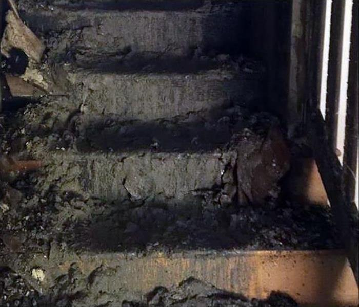 soot and fire damaged stairs