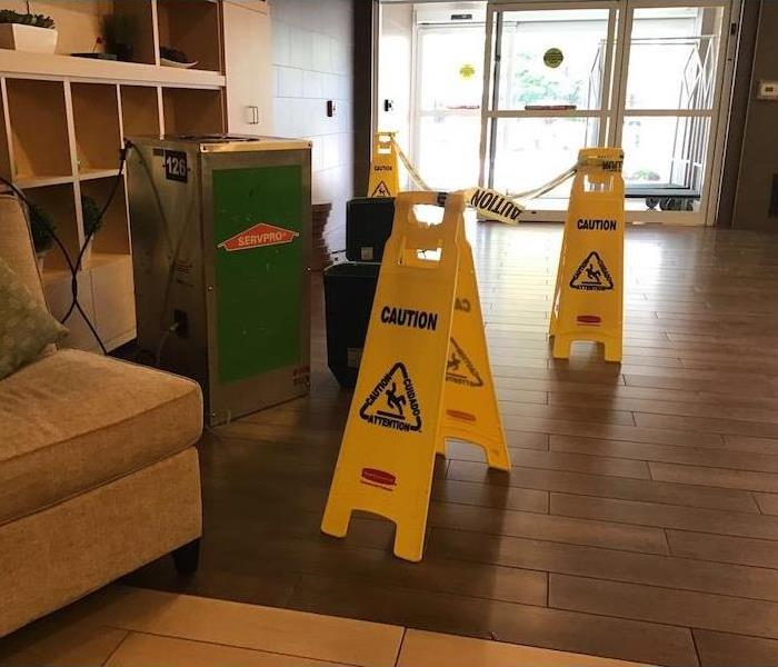 Hotel entrance with safety tape and a desiccant dehumidifier