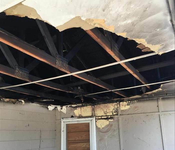 Fire on Porch, Punched hole in ceiling showing exposed burnt trusses