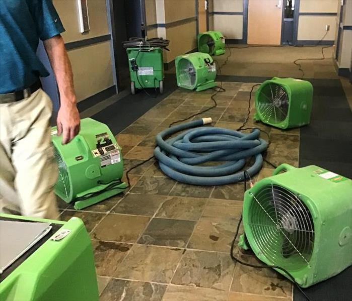 hallway of commercial building with SERVPRO equipment