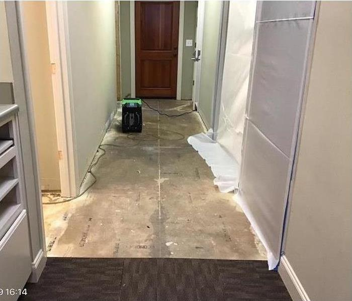 Our drying equipment drying the floor in this room after a water damage disaster
